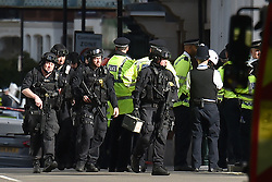 Armed police close to Parsons Green station in west London after an explosion on a packed London Underground train.