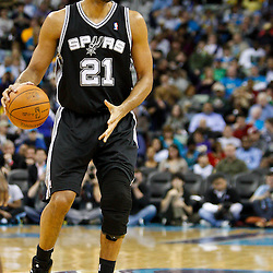 January 22, 2011; New Orleans, LA, USA; San Antonio Spurs center Tim Duncan (21) against the New Orleans Hornets during the third quarter at the New Orleans Arena. The Hornets defeated the Spurs 96-72.  Mandatory Credit: Derick E. Hingle