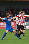 Mark Hughes and Andrija Novakovich during the FA Trophy match between Cheltenham Town and Chelmsford City at Whaddon Road, Cheltenham, England on 12 December 2015. Photo by Antony Thompson.