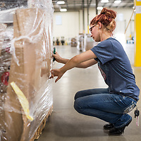 People at work in the Optoro Warehouse, Mount Juliet, Tennessee. Commercial, corporate, Nashville Photographer, documentary, photojournalist, photo journalist