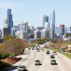 Chicago skyline and Lake Shore Drive with cars driving into downtown Chicago. Picture is high resolution and taken in October 2011. Includes some of Chicago's most popular office buildings and skyscrapers including Sears Tower / Willis Tower and Trump Tower.