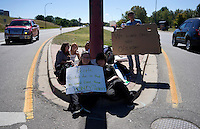 Protestors at Bear Creek High School in Lakewood, Colorado  sit on the street near the school September 25, 2014 as high school students in Colorado's second-largest school district staged a walkout again Thursday to protest proposed changes to a history curriculum that would stress patriotism and discourage civil disobedience. REUTERS/Rick Wilking (UNITED STATES)
