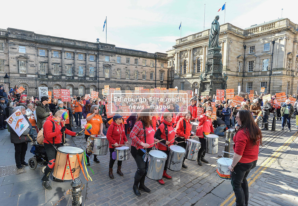 Demonstrators marched through Edinburgh today (Saturday) to the Scottish Parliament urging the government to strengthen the current legislation on fox hunting.<br /> <br /> © Dave Johnston / EEm