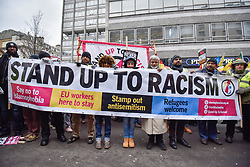 "© Licensed to London News Pictures. 17/03/2018. LONDON, UK.  People prepare to take part in a ""March against Racism"", walking from Portland Place to Downing Street, calling for a united movement for everyone against all forms of racism.  Photo credit: Stephen Chung/LNP"