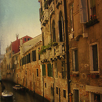 A canal in Venice with old houses