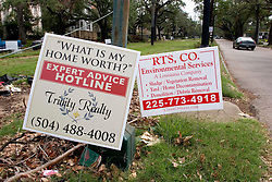 07 Oct, 2005. New Orleans, Louisiana. Hurricane Katrina aftermath.<br /> Signs ranging from hurricane clean-up, mould prevention, clear out, house sales, signs of all types litter the roadsides in most New Orleans neighbourhoods just a few weeks after the storm. <br /> Photo; ©Charlie Varley/varleypix.com