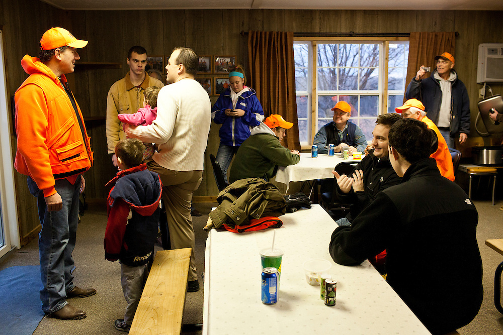 Republican presidential candidate Rick Santorum, left, talks with hunters after participating in a pheasant hunt on Monday, December 26, 2011 in Adel, IA.