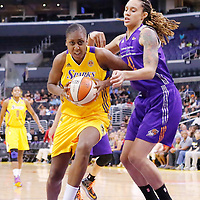 24 August 2014: Los Angeles Sparks forward/center Sandrine Gruda (7) drives past Phoenix Mercury center Brittney Griner (42) during the Phoenix Mercury 93-68 victory over the Los Angeles Sparks, in a Conference Semi-Finals at the Staples Center, Los Angeles, California, USA.