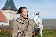 Falconry at Schloss Rosenburg, Walviertel region, Lower Austria. Pictured, Pictured, falconer Ulrike Stumvoll with a white Gyr Falcon (Falco rusticolus) © Rudolf Abraham