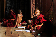 Monks on a Buddhist monastery classroom