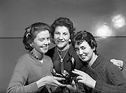"""15/12/1959<br /> 12/15/1959<br /> 15 December 1959<br /> <br /> Three of the """"Hello Girls"""" who will have to remain on duty at the Dublin P.O. exchange to connect greeting calls on Christmas day. Gabrielle Hurley (Co. Clare); Sadie Maguire and Marie Gill(Dublin)"""
