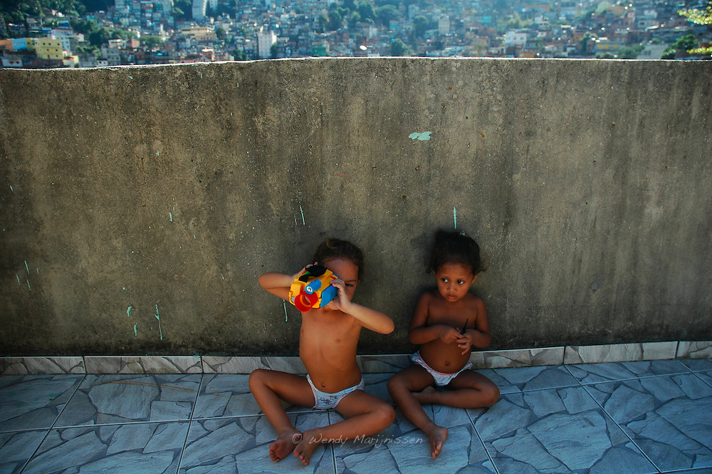 Children playing on the roof of the Rupa Suja project house in the middle of the Rocinha favela. Mothers for mothers, providing daycare in the biggest slum of Brazil. Rio de Janeiro, Brazil, 2008