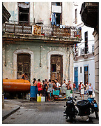 People queing for drinking water, Havana, Cuba.