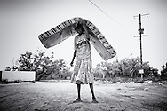 Lydia is moving here mattress to the side of the road. <br />