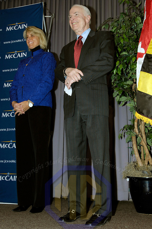 07 February 2008:   US Senator and Republican presidential candidate John McCain (R) stands with Kendel Ehrlich (L), wife of former Maryland governor Robert Erhlich before speaking to the Baltimore County Republican Lincoln Day Dinner in Halethorpe, Maryland on February 07, 2008. McCain's chief rival Mitt Romney pulled out of the presidential race earlier today, making him the presumed Republican nominee.