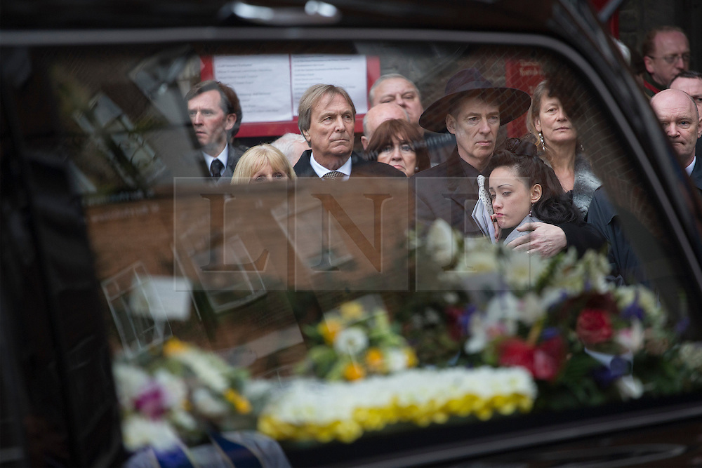 © licensed to London News Pictures. London, UK 20/03/2013. Family and friends of great train robber Bruce Reynolds mourning at his funeral at St Bartholomew The Great in London. Photo credit: Tolga Akmen/LNP