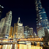 Chicago River skyline buildings at night with Dusable Bridge (formerly Michigan Avenue Bridge), Trump Tower,