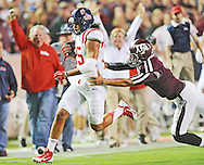 Mississippi Rebels defensive back Cody Prewitt (25) avoids the attempted tackle by Texas A&M Aggies quarterback Kenny Hill (7) to score in College Station, Texas on Saturday, October 11, 2014.