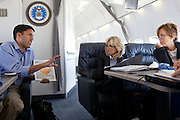 Dr. Jill Biden and Bernie Daley (right) are briefed by USAID Administrator Dr. Raj Shah, aboard a C-32 en route to Nairobi, Kenya, August 7, 2011. (Official White House Photo by David Lienemann)