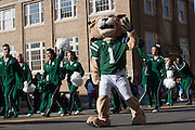 Rufus waves to people during the homecoming parade.