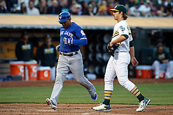 OAKLAND, CA - JULY 15:  Ezequiel Carrera #3 of the Toronto Blue Jays scores on a wild pitch by Daniel Mengden #67 of the Oakland Athletics during the third inning at the Oakland Coliseum on July 15, 2016 in Oakland, California. (Photo by Jason O. Watson/Getty Images) *** Local Caption *** Ezequiel Carrera; Daniel Mengden