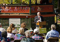 James Garvin, PSU Faculty, retired State Architectural Historian speaks to the crowd gathered at the historic Belmont Bandstand during the Community Salute on Sunday afternoon.  (Karen Bobotas/for the Laconia Daily Sun)