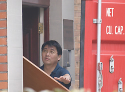 A North Korean embassy employee moves goods from inside the embassy near Ealing, London, into a removals truck amid rumours some of the embassy staff were leaving in view of the present tensions,Tuesday April 9, 2013. Photo by Max Nash / i-Images...
