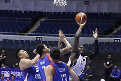 September 17, 2018 - Quezon City, NCR, Philippines - Tanguy Alban H Ngombo (8, White) of Qatar tries to lay the ball up over Poy Erram (7, Blue), Beau Belga (30, Blue) and Marcio Lassiter (13, Blue) of the Philippines. (Credit Image: © Dennis Jerome S. Acosta/Pacific Press via ZUMA Wire)