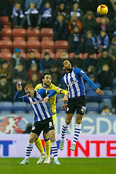 Ben Watson of Wigan, Atdhe Nuhiu of Sheffield Wednesday and James Perch of Wigan compete in the air - Photo mandatory by-line: Rogan Thomson/JMP - 07966 386802 - 30/12/2014 - SPORT - FOOTBALL - Wigan, England - DW Stadium - Wigan Athletic v Sheffield Wednesday - Sky Bet Championship.