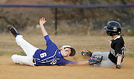 Chester, New York  - An infielder reaches to tag a runner sliding into second base during   the TRUMP March Madness youth baseball tournament at The Rock Sports Park on March 17, 2012.