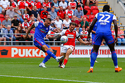 Luke Chambers of Ipswich Town clears the ball after pressure from Jon Taylor of Rotherham United - Mandatory by-line: Ryan Crockett/JMP - 11/08/2018 - FOOTBALL - Aesseal New York Stadium - Rotherham, England - Rotherham United v Ipswich Town - Sky Bet Championship