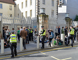 Climate change protesters started their second day of protest by blockading the entrances to the Scottish Parliament, including two protesters who glued themselves to the road outside the car park entrance to the Parliament. They were freed by specialist officers and arrested.<br /> <br /> © Dave Johnston / EEm