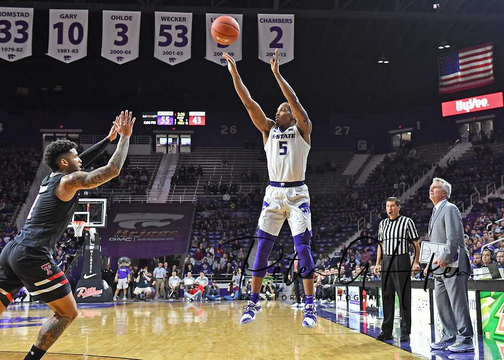 MANHATTAN, KS - JANUARY 22:  Barry Brown Jr. #5 of the Kansas State Wildcats puts up a shot against Brandone Francis #1 of the Texas Tech Red Raiders during the second half on January 22, 2019 at Bramlage Coliseum in Manhattan, Kansas.  (Photo by Peter G. Aiken/Getty Images) *** Local Caption *** Barry Brown Jr.;Brandone Francis