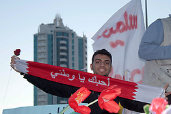 "© under license to London News Pictures. 19/02/2011. A protester holds up a banner which reads ""I Love My Country"" during a gathering at the Pearl Roundabout in Manama, Bahrain today (19/02/2011).  Photo credit should read Michael Graae/London News Pictures"