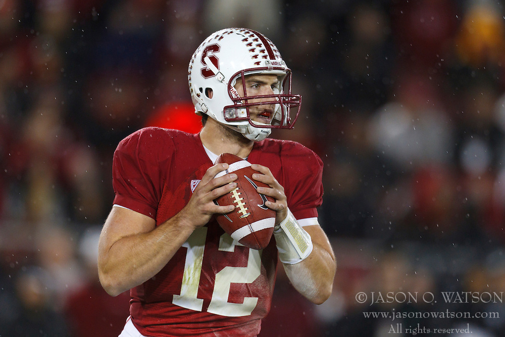Nov 19, 2011; Stanford CA, USA;  Stanford Cardinal quarterback Andrew Luck (12) stands in the pocket against the California Golden Bears during the first quarter at Stanford Stadium.  Stanford defeated California 31-28. Mandatory Credit: Jason O. Watson-US PRESSWIRE