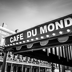 Cafe Du Monde black and white picture in New Orleans Louisiana. Established on 1862, Café Du Monde is a French market coffee stand restaurant in the French Quarter of New Orleans and is famous for serving beignets and chicory coffee.