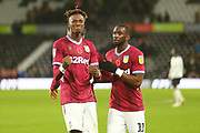 Aston Villa's Tammy Abraham (18) and Aston Villa's Yannick Bolasie (11) celebrate after the final whistle during the EFL Sky Bet Championship match between Derby County and Aston Villa at the Pride Park, Derby, England on 10 November 2018.