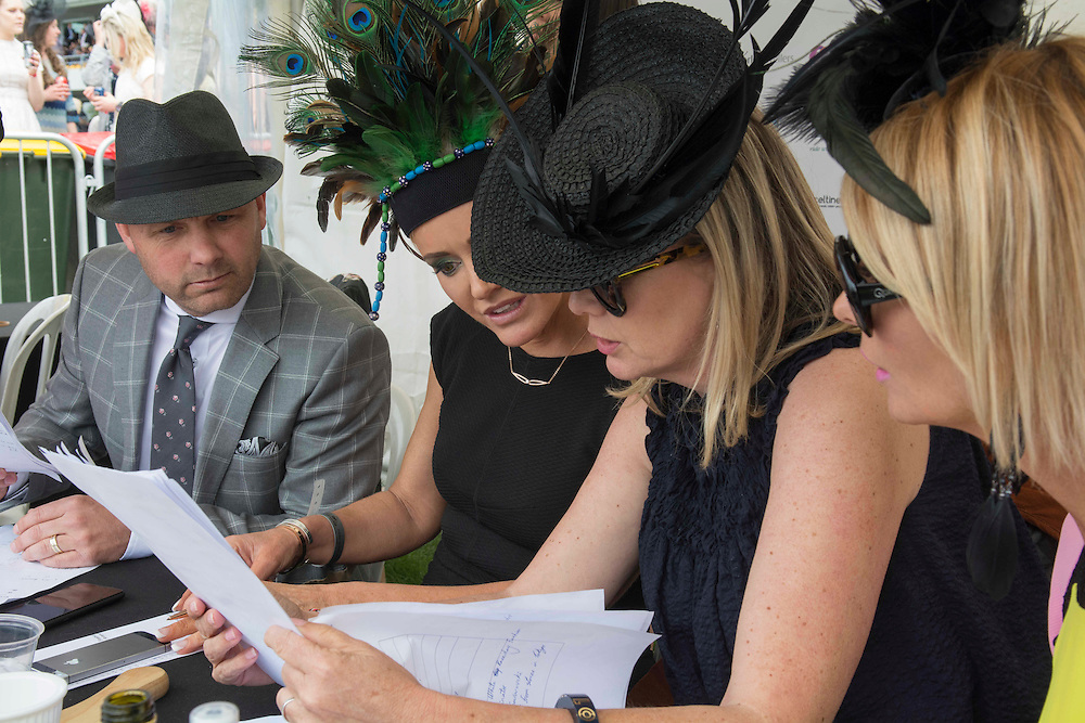 Judges for the Fashion in the Field contest, Paul Dean, left, Nettles LaMont, Mel Radford Brown and Amanda Linnell pick their winners Riccarton Racecourse, Christchurch, New Zealand, Saturday, 14 November, 2015.  <br /> Credit:SNPA / David Alexander