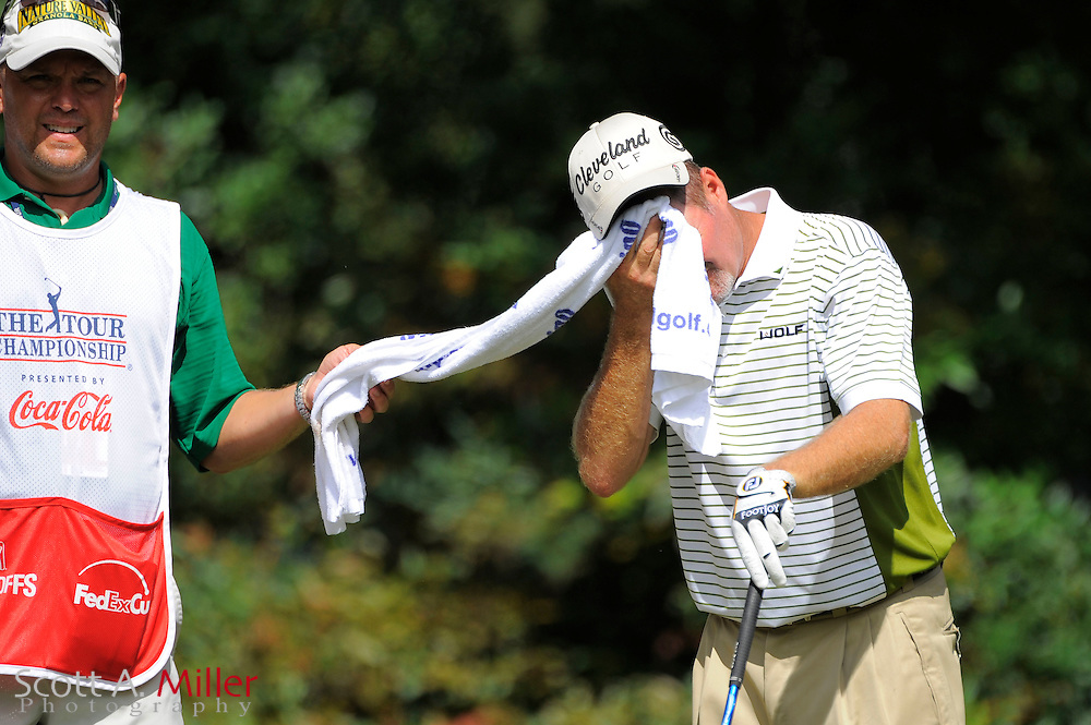 Jerry Kelly (USA) wipes his face while he waits to tee off on the fourth hole during the first round of the PGA Tour Championship at East Lake Golf Club on Sept. 24, 2009 in Decatur, Ga.     ..©2009 Scott A. Miller