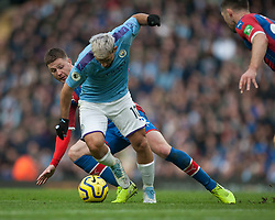 Sergio Aguero of Manchester City (Front) and James McCarthy of Crystal Palace in action - Mandatory by-line: Jack Phillips/JMP - 18/01/2020 - FOOTBALL - Etihad Stadium - Manchester, England - Manchester City v Crystal Palace - English Premier League