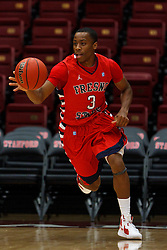 Nov 15, 2011; Stanford CA, USA;  Fresno State Bulldogs guard Kevin Olekaibe (3) dribbles the ball up court against the Southern Methodist Mustangs during the first half of a preseason NIT game at Maples Pavilion.  Fresno State defeated Southern Methodist 54-52. Mandatory Credit: Jason O. Watson-US PRESSWIRE