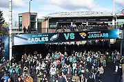 Fans stream down Wembley way from Wembley Park Tube Station  match between Jacksonville Jaguars and Philadelphia Eagles at Wembley Stadium, London, England on 28 October 2018.