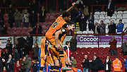 Chuba Akpom on the back of Andrew Robertson celebrates Hull's victory after the Sky Bet Championship match between Brentford and Hull City at Griffin Park, London, England on 3 November 2015. Photo by Michael Hulf.