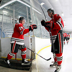 TORONTO, ON - Feb 16 : Ontario Junior Hockey League Game Action between the Milton Ice Hawks and the Toronto Jr. Canadiens, Daniel Poutsoungas #24 of the Milton Ice Hawks Hockey Club and Shane Bennett #18 of the Milton Ice Hawks Hockey Club before the start of the game.<br /> (Photo by Brian Watts / OJHL Images)