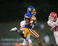 Oxford High's D.K. Metcalf (14) is hit by Jackson Prep's Eric Wegener (19) in Oxford, Miss. on Friday, August 23, 2013. Oxford won 32-20.
