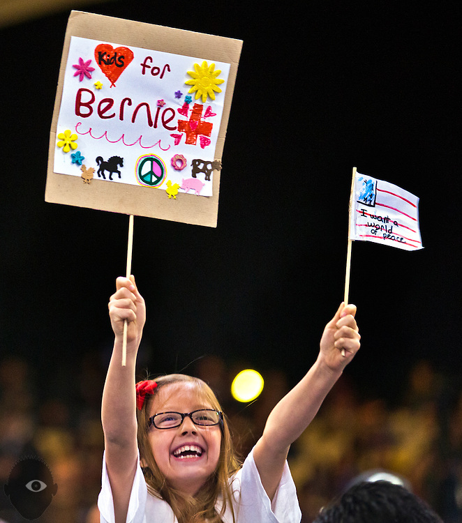 A young supporter displays her handmade signs as Democratic presidential candidate Bernie Sanders speaks at a campaign rally at the Henderson Pavilion, Friday, Feb. 19, 2016.