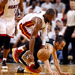 Jun 9, 2013; Miami, FL, USA;  Miami Heat shooting guard Dwyane Wade (3) and San Antonio Spurs shooting guard Manu Ginobili (20) go after a loose ball during the first quarter of game two of the 2013 NBA Finals at the American Airlines Arena. Mandatory Credit: Derick E. Hingle-USA TODAY Sports