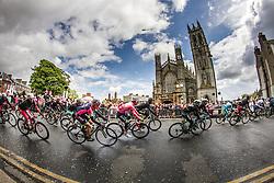 Peloton with pink leaders jersey cycling along church, Stage 3 Armagh » Dublin, Giro d'Italia, Dublin, Ireland, 11th May 2014, Photo by Thomas van Bracht / www.pelotonphotos.com