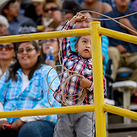 Carlyle Begay practices his lasso skills on a handrail while celebrating his third birthday at the PRCA July 4th Rodeo at the Dean Jackson Arena in Window Rock Tuesday.