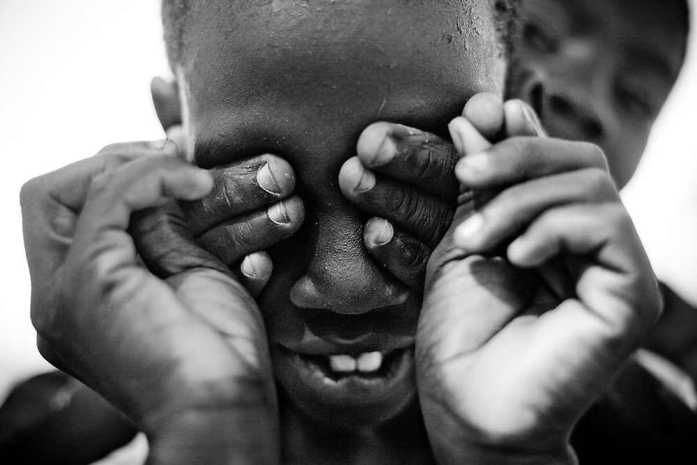Two boys play in a camp for those displaced by the recent earthquake in Petionville, outside Port-au-Prince, Haiti.